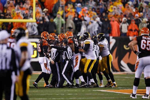 CINCINNATI, OH - JANUARY 9: Officials try to separate the Cincinnati Bengals and the Pittsburgh Steelers in the second half of the AFC Wild Card Playoff game at Paul Brown Stadium on January 9, 2016 in Cincinnati, Ohio. The Steelers defeated the Bengals 18-16. (Photo by Joe Robbins/Getty Images)