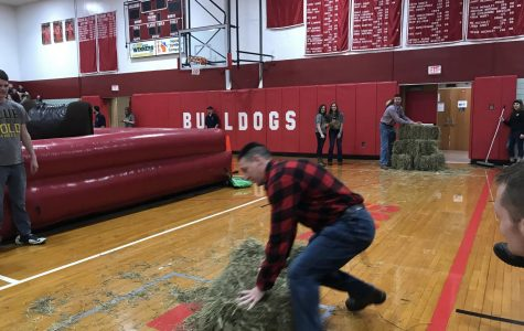 Mr. Hartle  using those artistic skills to stack the hay bale.