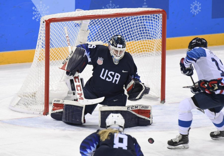 Maddie Rooney makes a save in the gold medal game. Photo Credit to the Denver Post