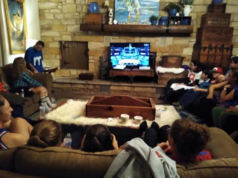 The crowd of Bible Club members watching their friends play Mario Smash Brothers.